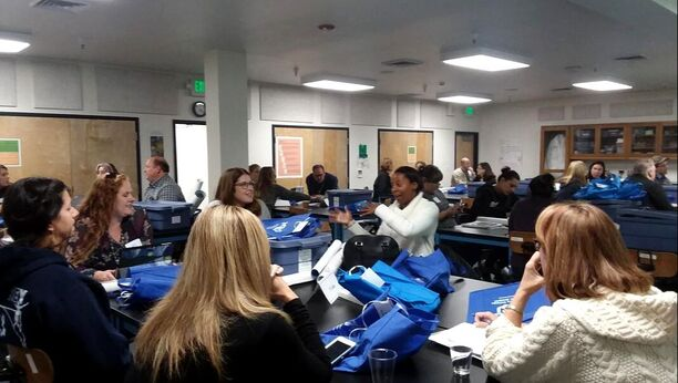 Teachers sitting at tables during a training